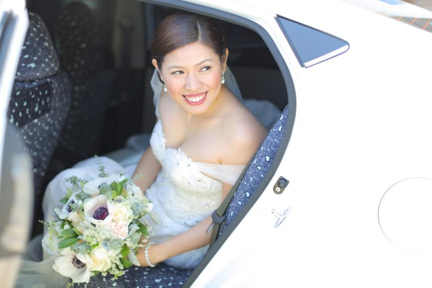 bridal car with flower bouquet