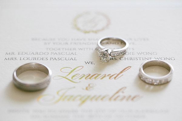 Engagement and wedding rings, wedding invitation